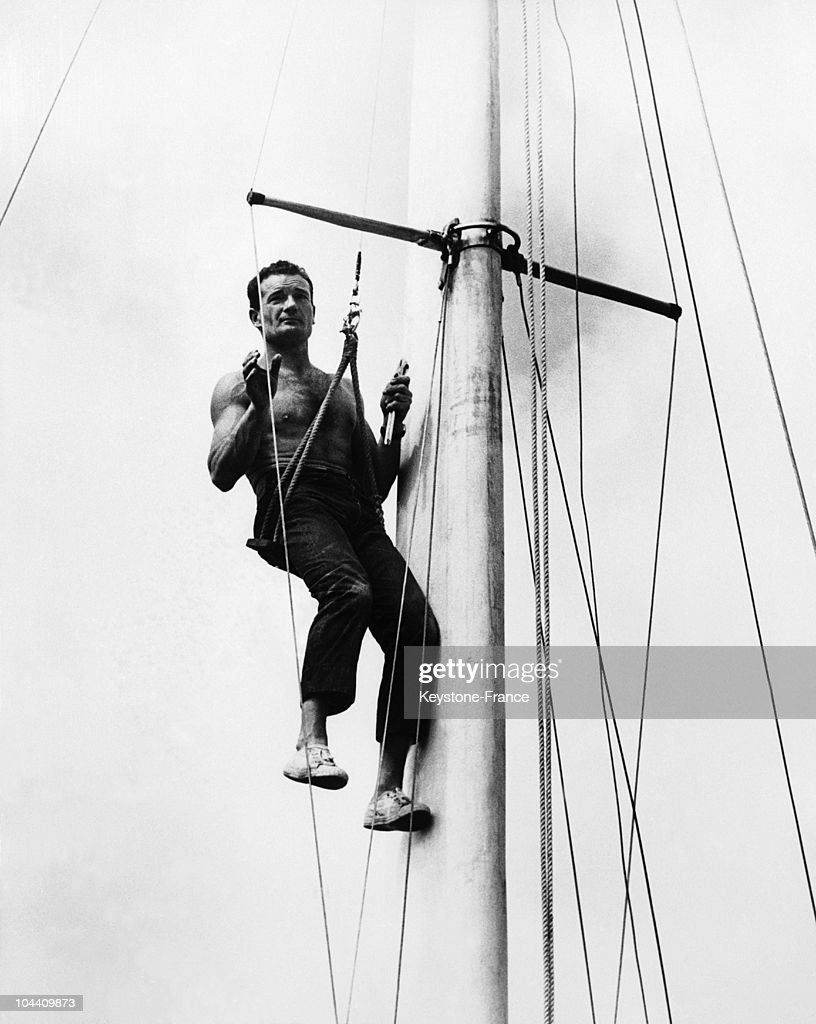 The French Sailor Eric Tabarly Repairing The Mast Of His Trimaran The Pen Duick Iv In