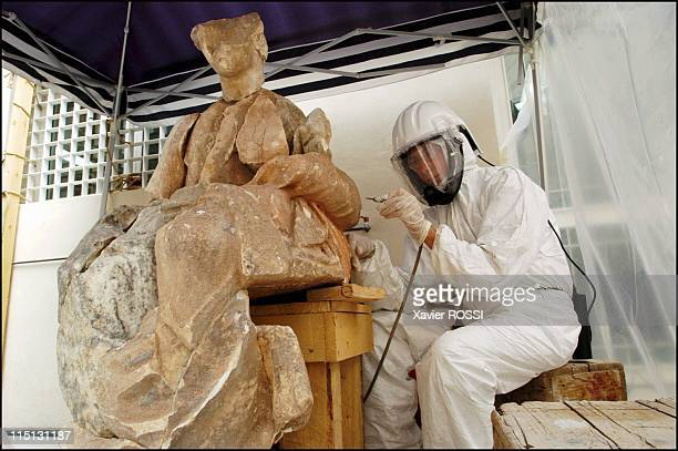 The French school of Athens A group of French scholars devoted to the examination of Greek treasures in Delphi Greece in July 2003 French restoration...