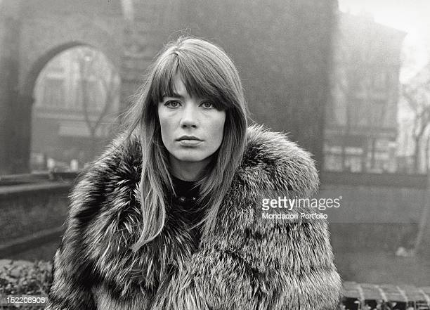 The French singer and actress Francoise Hardy wearing a fur coat in Piazza Sant'Ambrogio. Milan, 1960s
