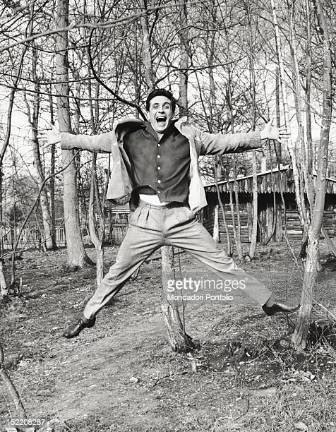 The French singer and composer Gilbert Bécaud joking in a wood 1959