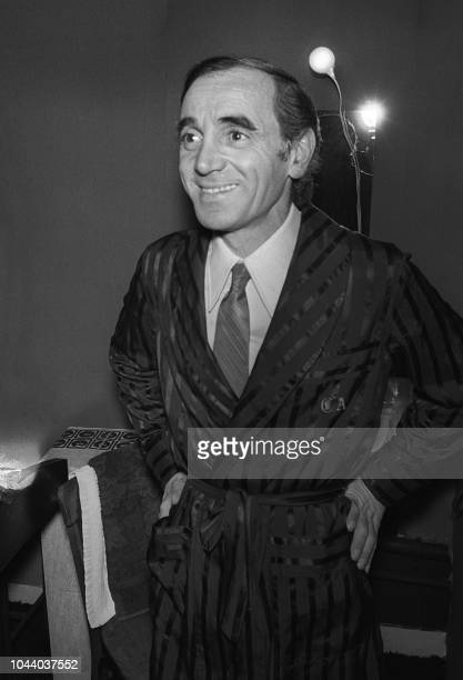 The French singer Charles Aznavour prepares himself in his box before performing on the stage of the Olympia in Paris on November 16 1972