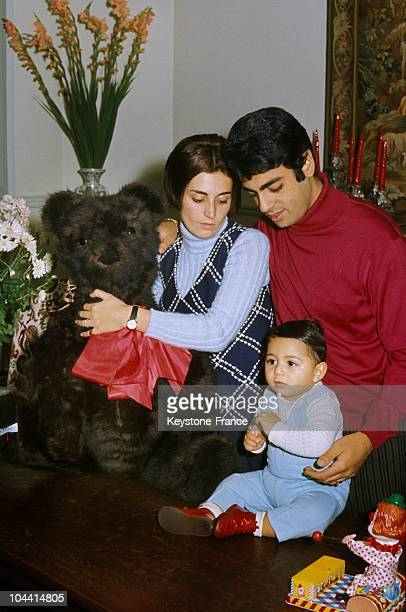 The French singer Enrico MACIAS with his wife Suzy, holding a stuffed animal, and his son Jean-Claude at his home on boulevard MALESHERBES in Paris...
