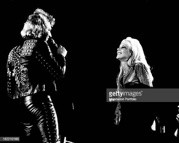 The French singer Johnny Hallyday performing on stage with his wife the French singer Sylvie Vartan Milan 1973