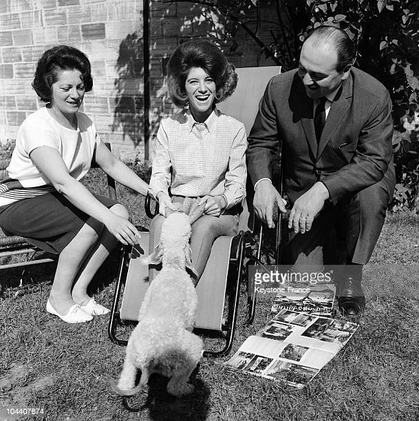 The French singer SHEILA convalescing following her hospitalization in the company of her parents and her dog MIEL on May 17 1964
