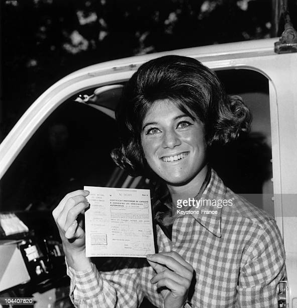 The French singer SHEILA joyfully displayed the driver's license which she had just obtained in Versailles on September 18 1964
