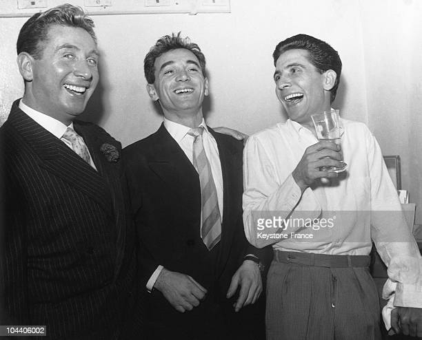The French singers Charles TRENET Charles AZNAVOUR and Gilbert BECAUD in one of the dressing rooms of the Olympia Paris