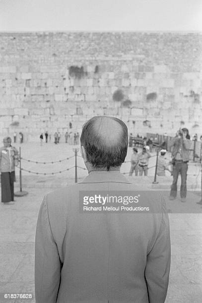 The French Socialist Party's first secretary Francois Mitterand looks across at the Western Wall in Jerusalem. Mitterand was part of a Socialist...