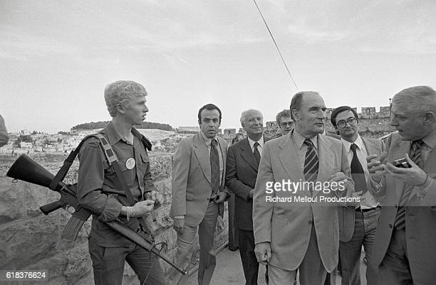 The French Socialist Party's first secretary Francois Mitterand talks with French politicians Gaston Deferre and Jacques Attali at the Western Wall...