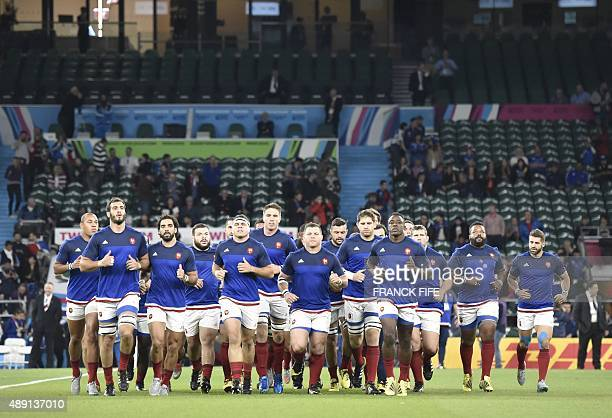 The French squad warm up before a Pool D match of the 2015 Rugby World Cup between France and Italy at Twickenham stadium, south west London on...