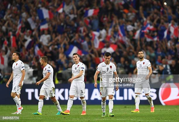 The French supporters celebrate as the Albanian players look dejected following defeat during the UEFA EURO 2016 Group A match between France and...