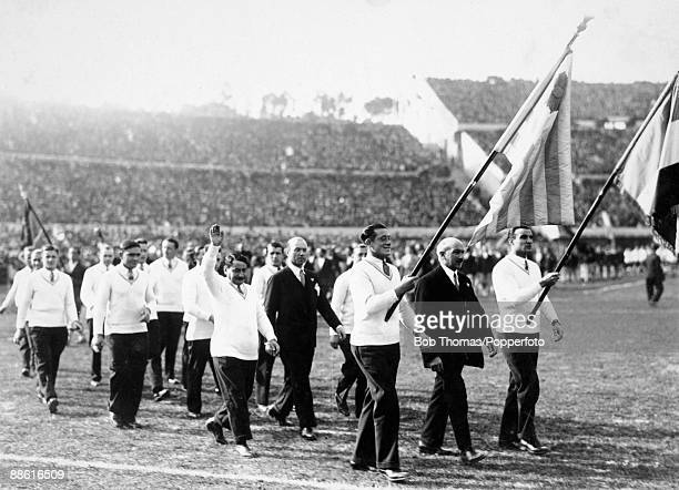 The French team and delegation parade around the Estadio Centenario in Montevideo during the ceremony to officially open the stadium prior to the...
