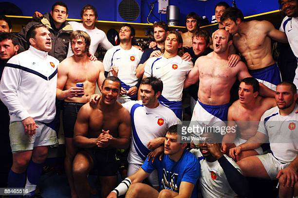 The French team celebrate in the dressing room following the First Test match between the New Zealand All Blacks and France at Carisbrook on June 13...