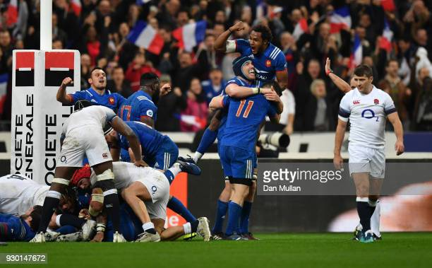 The French team celebrate victory after the NatWest Six Nations match between France and England at Stade de France on March 10 2018 in Paris France