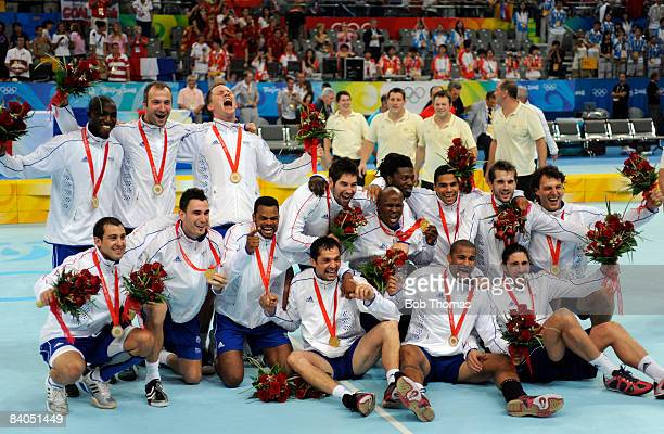 The French team celebrate with their Gold Medals following their victory in the Men's Handball Gold Medal Match between France and Iceland held at...