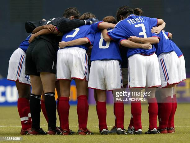 The French team huddles beofre the start of the second period of their FIFA Women's World Cup Group B soccer match against Brazil 27 September at RFK...