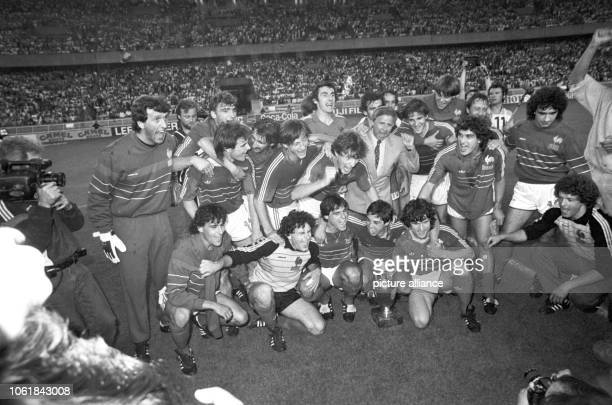 The French team is cheering its UEFA Euro victory on 27 June 1984 at Parc des Princes in Paris with their coach Michel Hidalgo The French team...