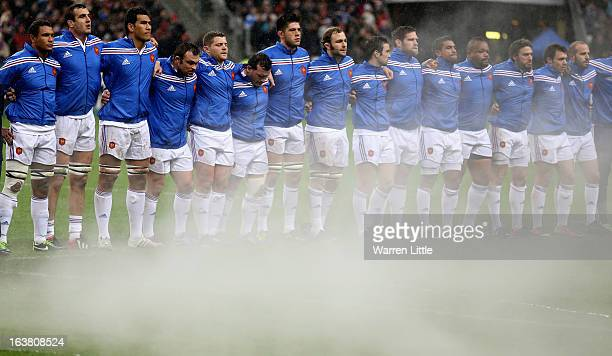 The French team line up for the anthems ahead of the RBS Six Nations match between France and Scotland at Stade de France on March 16 2013 in Paris...