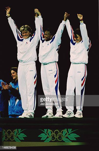 The French team on the podium after winning the gold medal in the women's team epee at the Georgia World Congress Center during the Atlanta Olympics...