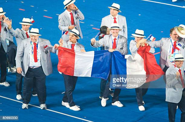 The French team wave to the crowd during the Opening Ceremony for the 2008 Paralympic Games at the National Stadium on September 6 2008 in Beijing...