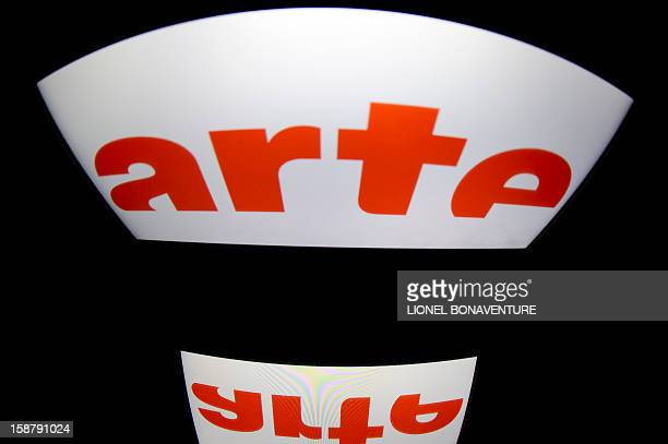 """The French television channel """"Arte"""" logo, is displayed on a tablet screen, on December 29, 2012 in Paris. AFP PHOTO / LIONEL BONAVENTURE"""