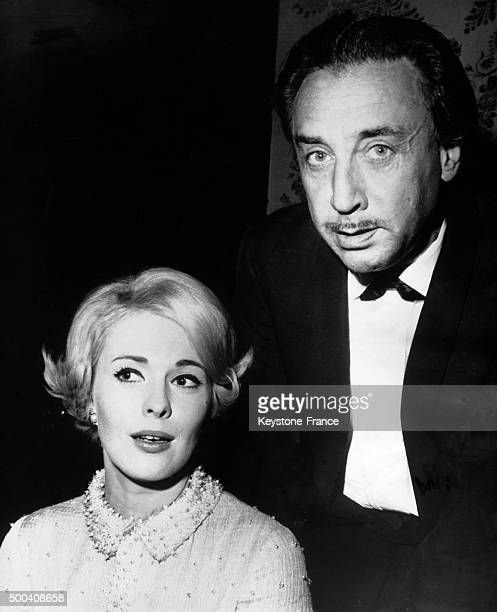 The French writer Romain Gary consul in California and his wife the American actress Jean Seberg at a television producers banquet at the...