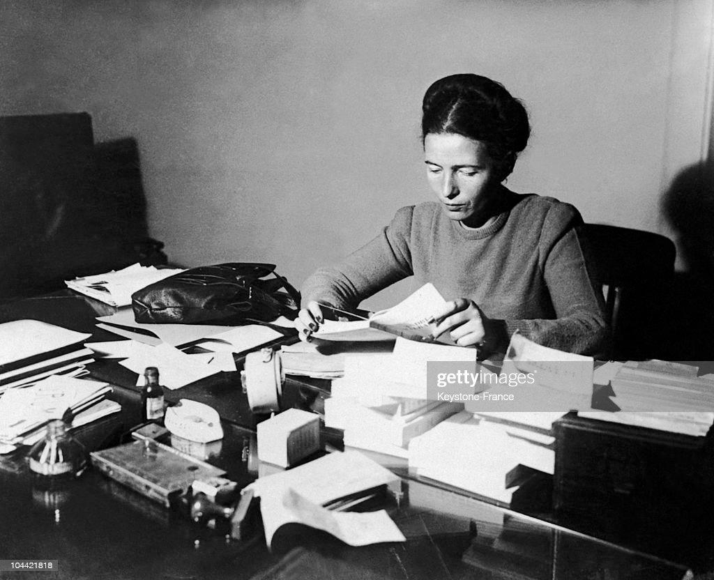 Simone De Beauvoir Reading At Her Desk In 1953 : News Photo