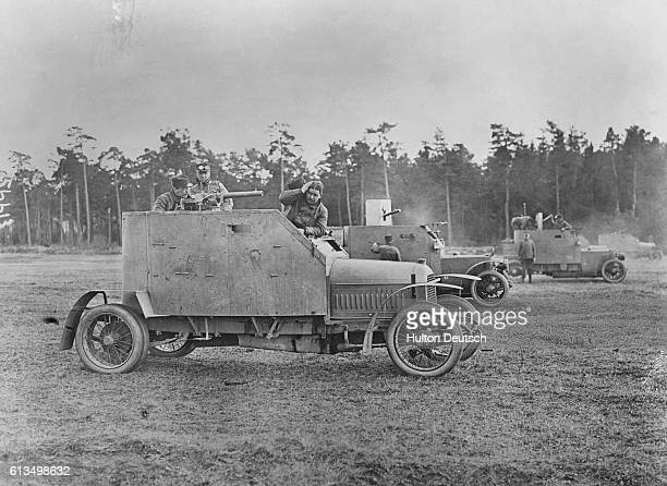 The Frenchbuilt Peugot armoured car was used by the Belgian army during the First World War The other vehicles in the background are Belgian Mors...