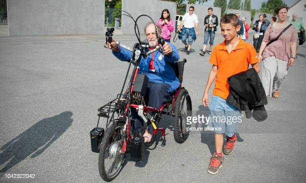The Frenchman Guy Patin and French pupils at the memorial place Sachsenhausen in Oranienburg Germany 26 July 2014 Through the travel with a handbike...