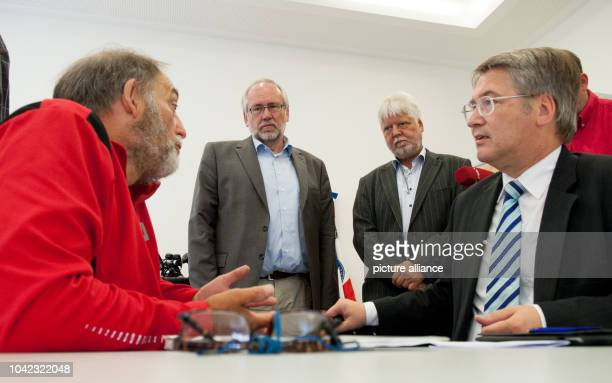 The Frenchman Guy Patin talks to the head of the memorial place Sachsenhausen Guenther Morsch Brandenburg's Minister of Justice Helmuth Markov and...