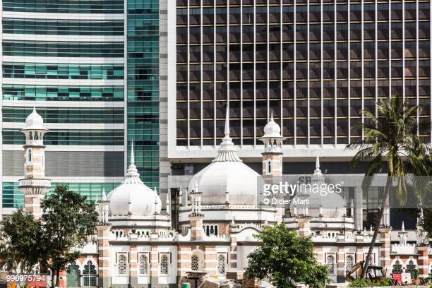 the friday mosque, or masjid jamek, in front of bank buildings in kuala lumpur, malaysia capital city - minaret stock pictures, royalty-free photos & images