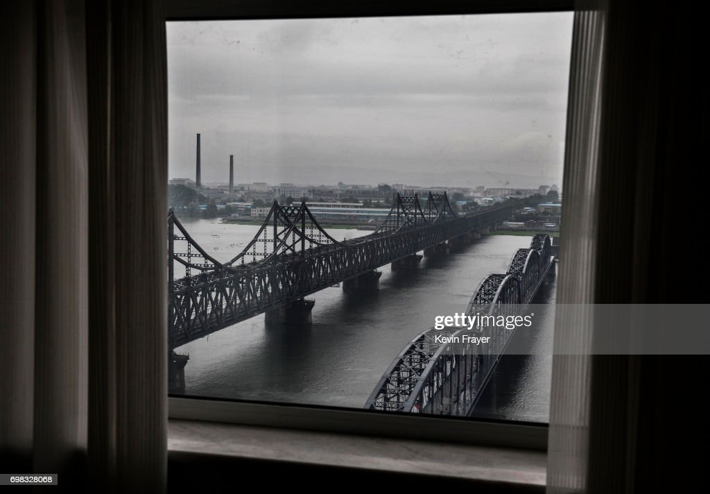 The 'Friendship Bridge', left, and 'Broken Bridge' are seen on the Yalu river from the border city of Dandong, Liaoning province, northern China across from the city of Sinuiju, North Korea on May 23, 2017 in Dandong, China. China has long been North Korea's main ally and trading partner, but relations are increasingly strained by continued missile testing and provocations by the regime of Kim Jong Un. The North is almost entirely dependent on trade with China to feeds its impoverished economy, yet it has ignored calls by the international community to halt its nuclear and ballistic missile weapons programs. At least three-quarters of trade between the two nations flows through points along its 880-mile long shared border, a divide that reveals stark contrasts in development. Cities such as Dandong boast high-rise buildings and advanced infrastructure, and the Friendship Bridge serves as the conduit for the bulk of trade. From hired boats along the Yalu river, Chinese tourists peer into the reclusive North, marked by soldiers, meagre villages, and depleted farmland. The United States has pressured China to do more to leverage its clout with North Korea, though Beijing remains concerned that outright regime collapse in Pyongyang could trigger a rush of refugees across the border.