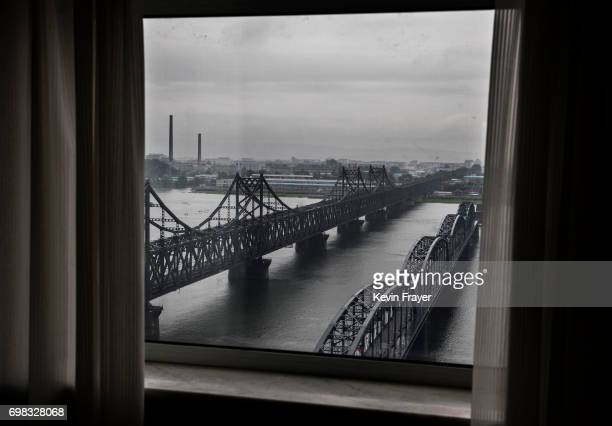 The 'Friendship Bridge' left and 'Broken Bridge' are seen on the Yalu river from the border city of Dandong Liaoning province northern China across...