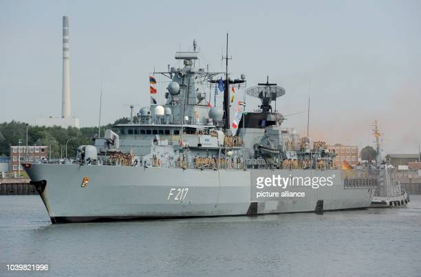 """The frigate """"Bayern"""" returns after a 5-month mission off the coast of Somalia, to its home base at Wilhelmshaven, Germany, 3 July 2015. The """"Bayern""""..."""