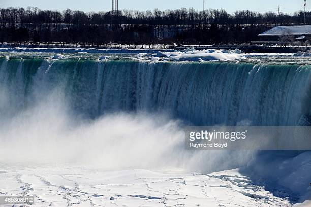 The frigid water of Niagara Falls empties into the frozen Niagara River on the Canada side of Niagara Falls on February 28, 2015 in Niagara Falls,...