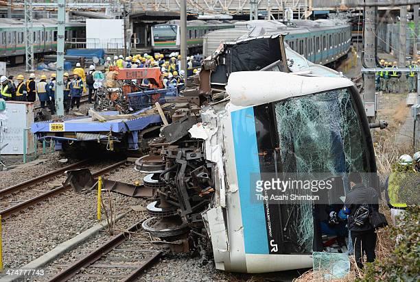 The front car of a JR East train is seen derailed near Kawasaki station on February 23 2014 in Kawasaki Kanagawa Japan An outofservice train derailed...
