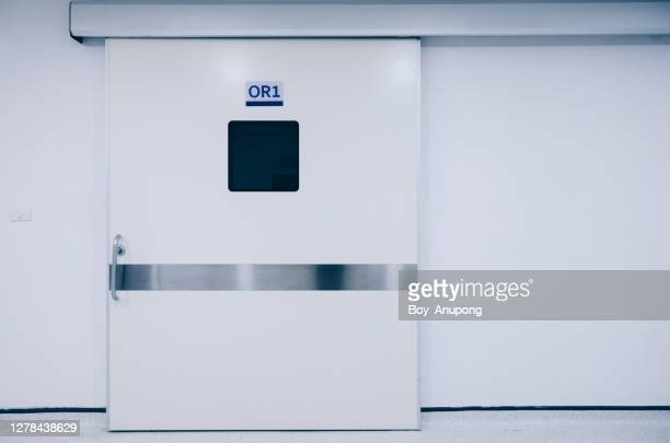 the front door before entering to operating room in hospital. - clinic stock pictures, royalty-free photos & images