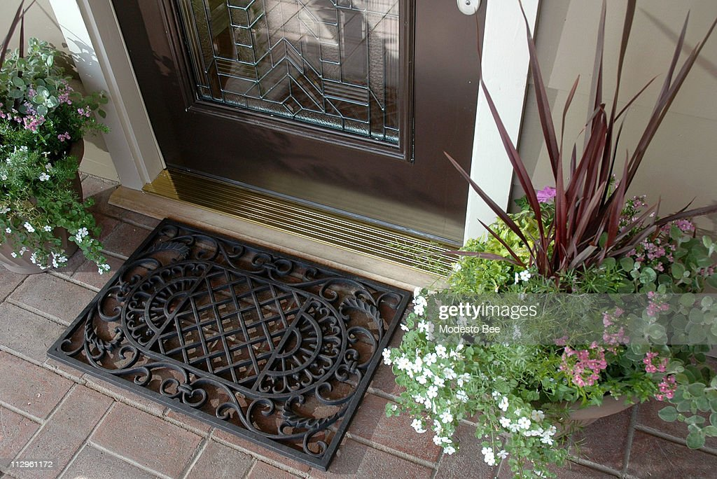 The Front Door Welcome Mat And The Appealing Planters On Eit