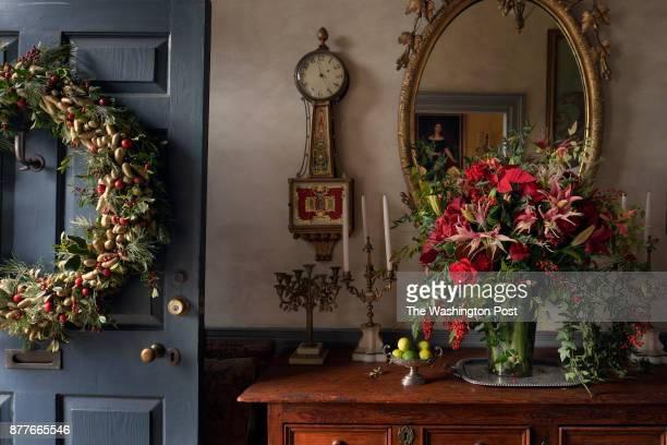 the front door with a wreath and entry way of former White House Floral Designer Laura Dowling for the Christmas issue photographed in Alexandria VA...