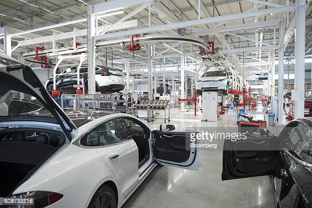 The front doors of Tesla Model X sports utility vehicles sit open during assembly for the European market at the Tesla Motors Inc factory in Tilburg...