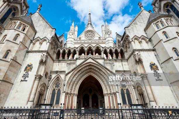 The front entrance to The Royal Courts of Justice is pictured on The Strand in central London on August 21, 2016. - The Royal Court of Justice...
