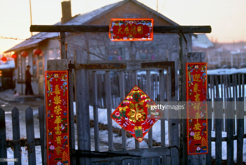 the front gate of a house is decorated traditionally for the chinese new year on february - Chinese New Year 1999