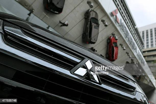 The front grill of Mitsubishi Motors Corp's new Outlander PHEV vehicle is seen during its unveiling at the company headquarters in Tokyo Japan on...
