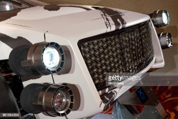 The front grille and headlights are seen on Xing Mobility Inc's Miss R electric supercar on display in Hong Kong China on Wednesday May 23 2018 Xing...