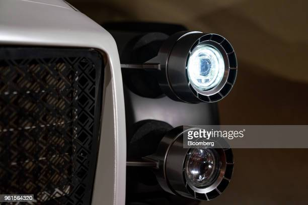 The front headlights are seen on Xing Mobility Inc's Miss R electric supercar on display in Hong Kong China on Wednesday May 23 2018 Xing Mobility...