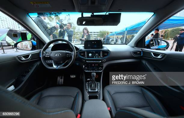 The front interior of Hyundai's Autonomous IONIQ vehicle is viewed at the 2017 Consumer Electronics Show in Las Vegas Nevada on January 4 2017 / AFP...