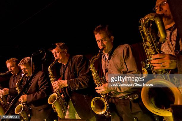 The front line of the Vanguard Jazz Orchestra performs at the Village Vanguard nightclub New York New York February 5 2008 Pictured are from left...