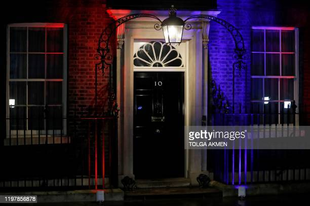 The front of 10 Downing Street the official residence of Briatin's Prime Minister is illuminated in red and blue lights in central London on January...