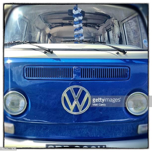 The front of a 1971 second generation or T2 bay window Volkswagen Transporter van is seen on August 8 2014 in Cornwall England The Volkswagen...