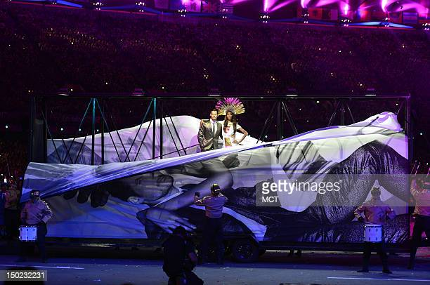The front of a supermodels billboard on wheel drop to reveal live models during the playing of David Bowie's Fashion at the Olympic Stadium in London...