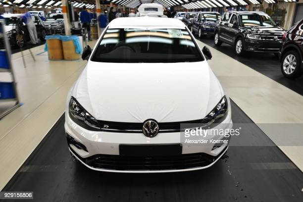 The front of a Volkswagen Golf car is displayed at an assembly line at the Volkswagen factory on March 8, 2018 in Wolfsburg, Germany. U.S. President...